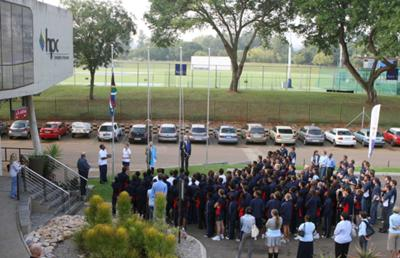 TuksSport learners raise the flag to welcome the Argentinean Soccer Team